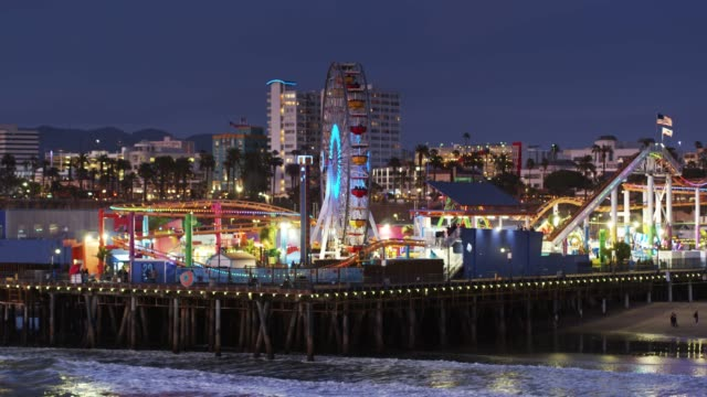 aerial establisher of santa monica pier at night - santa monica pier stock videos & royalty-free footage