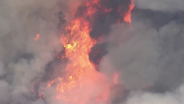 aerial establishing shot of a wildfire burning in napa county, california. - environment or natural disaster or climate change or earthquake or hurricane or extreme weather or oil spill or volcano or tornado or flooding stock videos & royalty-free footage