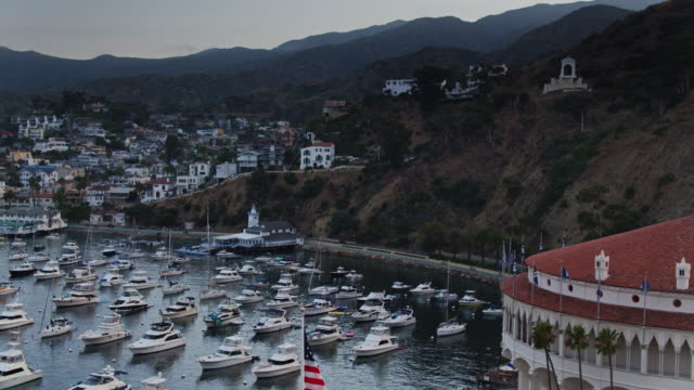 aerial establishing shot of avalon, catalina island at dusk - channel islands california stock videos & royalty-free footage