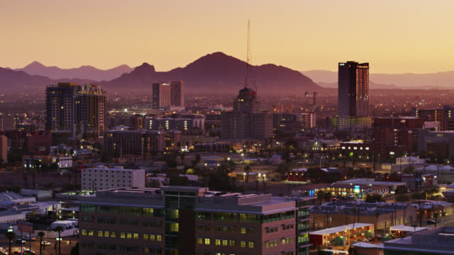 aerial establishing shot of downtown phoenix at sunrise - arizona stock videos & royalty-free footage
