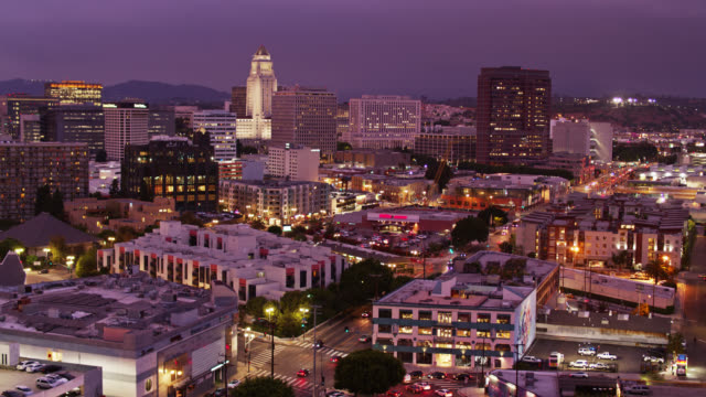 aerial establishing shot of dtla arts district and little tokyo at twilight - los angeles county stock-videos und b-roll-filmmaterial