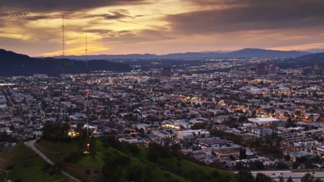 aerial establishing shot of glendale, ca at sunset - glendale california stock videos & royalty-free footage