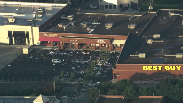 aerial establishing shot of looting damage and aftermath at an outdoor shopping mall in chicago. - crime or recreational drug or prison or legal trial stock videos & royalty-free footage
