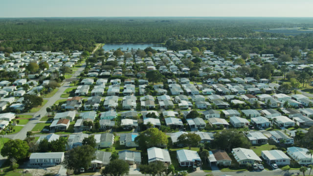 aerial establishing shot of manufactured homes in florida - florida us state stock videos & royalty-free footage