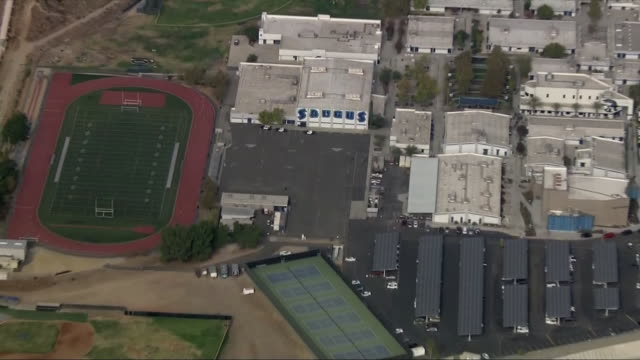 aerial establishing shot of saugus high school in santa clarita california - santa clarita stock videos & royalty-free footage