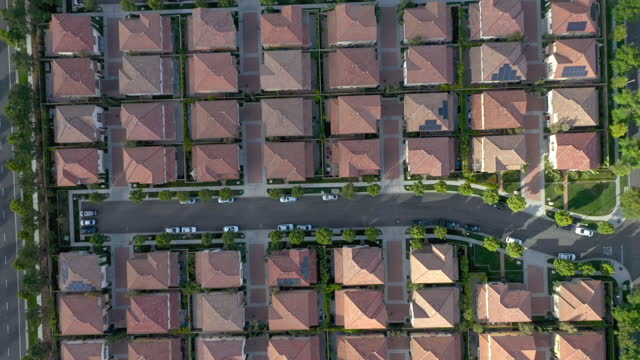 aerial establishing shot of southern california neighborhood where all the houses look the same - part of a series stock videos & royalty-free footage