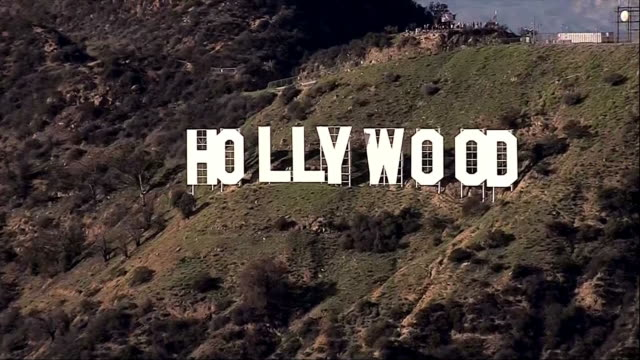 aerial establishing shot of the hollywood sign in los angeles, california. - hollywood california stock videos & royalty-free footage
