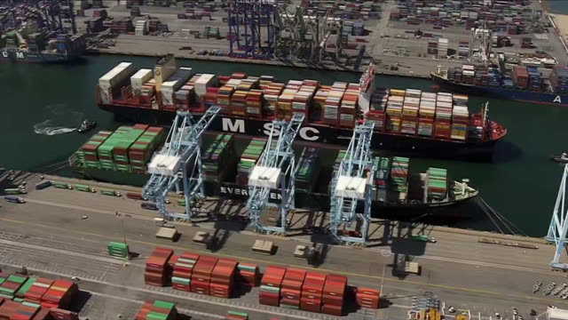 aerial establishing shot of the msc mia container ship arriving in the port of los angeles. - port of los angeles stock videos & royalty-free footage