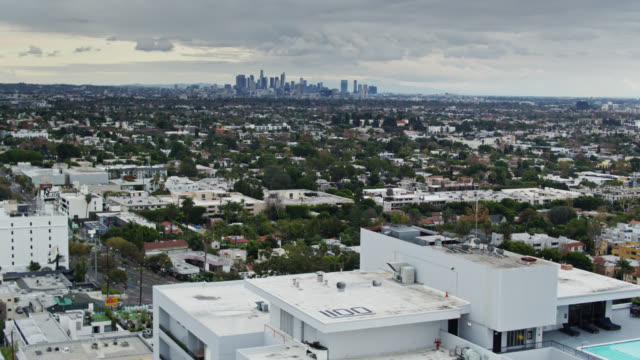 aerial establishing shot of west hollywood with the downtown los angeles skyline - west hollywood stock videos & royalty-free footage