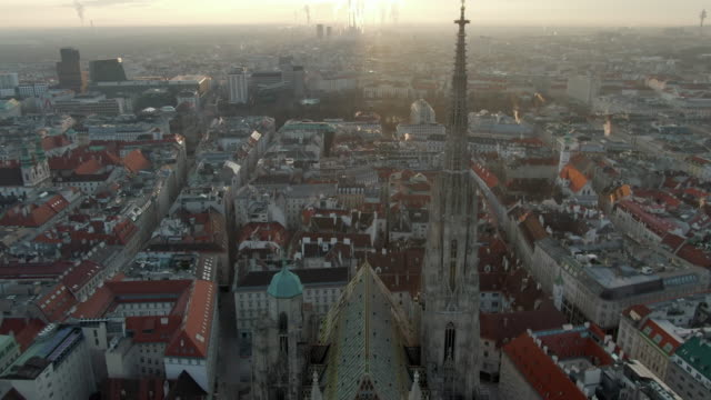 aerial: evening cityscape with st. stephen's cathedral in vienna, austria - vienna stock videos & royalty-free footage