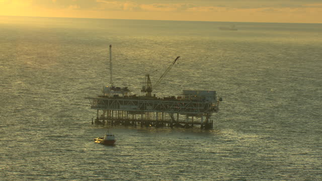 aerial exploration platform drilling rig sunset oil usa - seabed stock videos & royalty-free footage