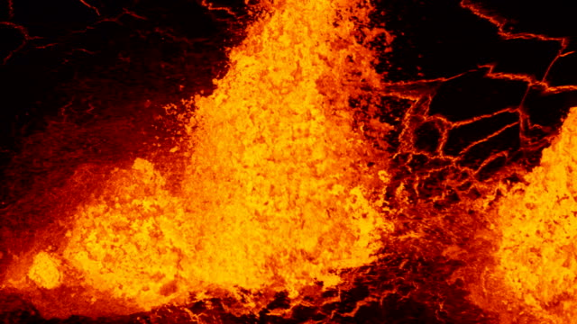 aerial explosive molten lava spewing from erupting fissure - eruzione video stock e b–roll