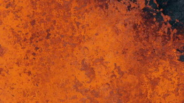 aerial explosive molten lava spewing from erupting volcano - 火山点の映像素材/bロール