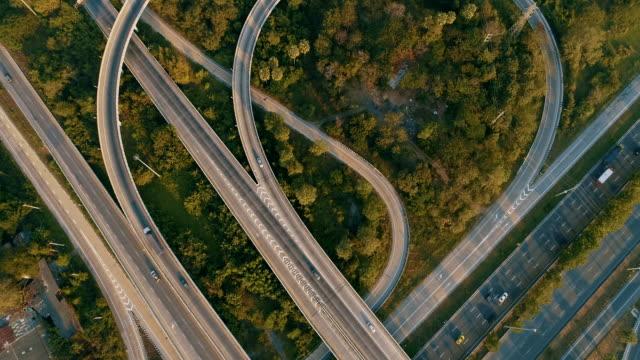 vídeos de stock e filmes b-roll de aerial expressways that are heavily traveled. - road junction