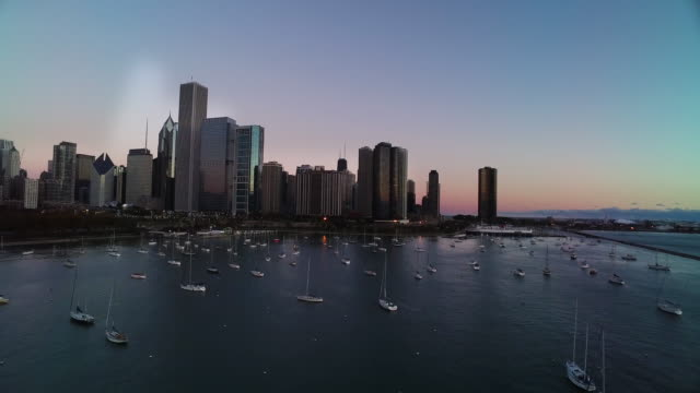 aerial facing north over monroe harbor toward chicago skyline - one prudential plaza stock videos & royalty-free footage
