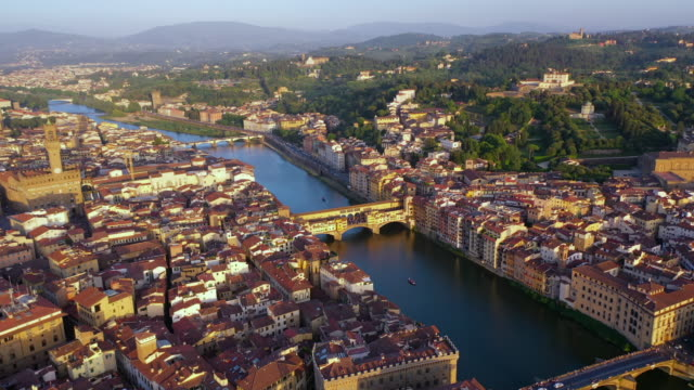 aerial: famous ponte vecchio bridge with stunning cityscape - florence, italy - tuscany stock videos and b-roll footage