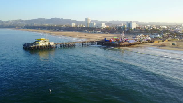 aerial: far and wide exit of santa monica pier - santa monica pier stock videos & royalty-free footage