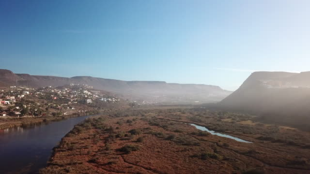 Aerial: Fast Ascent from Lagoon and Mountain of Baja Mexico