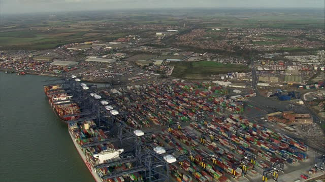 aerial felixstowe port with shipping containers backed up due to disruption in global supply trade caused by coronavirus pandemic and brexit... - industrial equipment stock videos & royalty-free footage