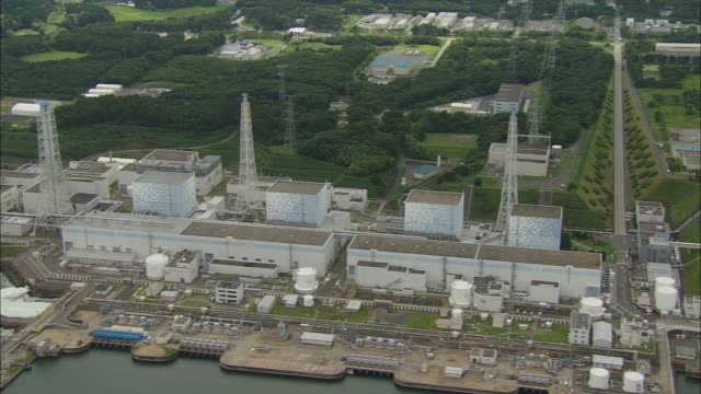 aerial file footage of the daiichi nuclear power plant in fukushima, japan before being hit by the march 2011 earthquake. footage courtesy of tofuna.... - nuclear reactor stock videos & royalty-free footage