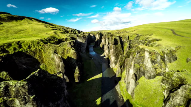 aerial : fjadrargljufur canyon in iceland - crevice stock videos & royalty-free footage