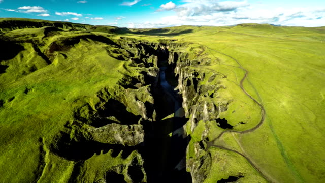 aerial : fjadrargljufur canyon landscape in iceland - canyon stock videos & royalty-free footage