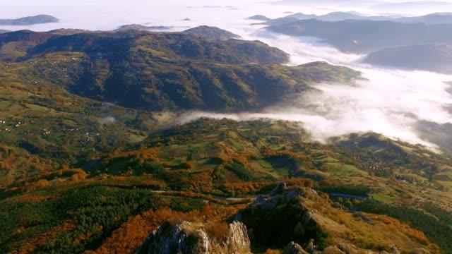 Aerial fligh over a mountain ridge peak