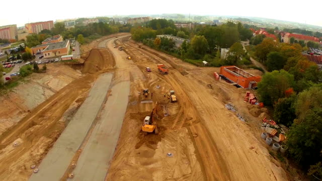 aerial flight over construction site - roadworks stock videos & royalty-free footage