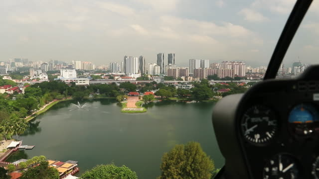 aerial flight over kuala lumpur in a helicopter - helicopter tour stock videos and b-roll footage