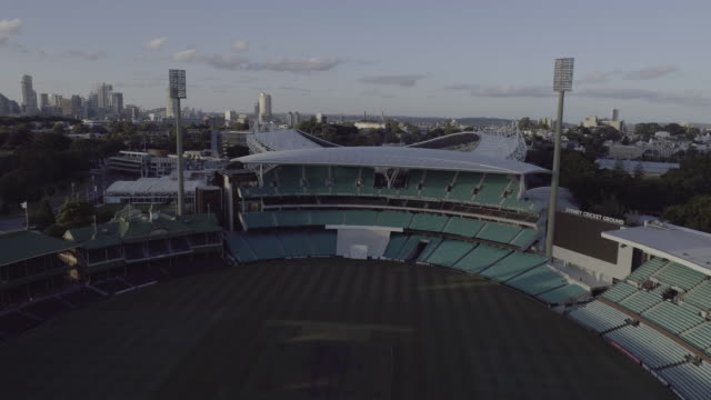 aerial flight over the sydney cricket ground and the sydney football stadium. moore park sydney australia - ニューサウスウェールズ州点の映像素材/bロール