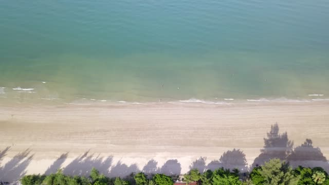 4k aerial flight over white sandy beach and beautiful blue ocean beautiful seascape at chao lao beach in thailand. - satoyama scenery stock videos & royalty-free footage