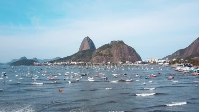 aerial flight to sugarloaf mountain in rio de janeiro, brazil - rio de janeiro stock videos & royalty-free footage