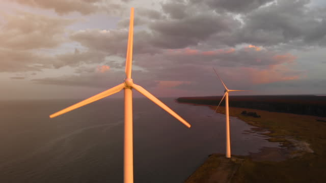 aerial flight towards spinning wind turbine - alternative energy stock videos & royalty-free footage