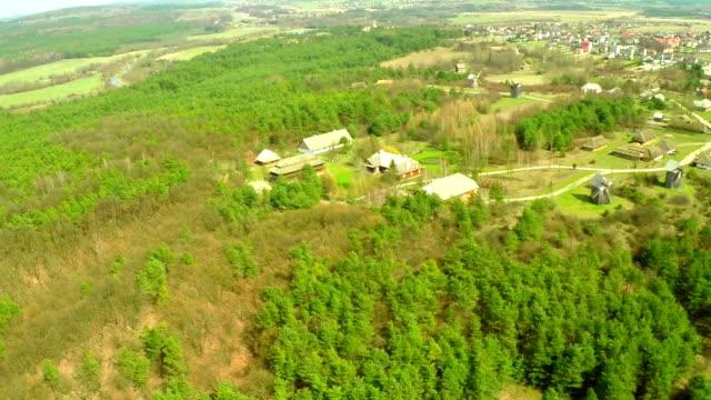 Aerial flight view of a green natural and historical village Tokarnia