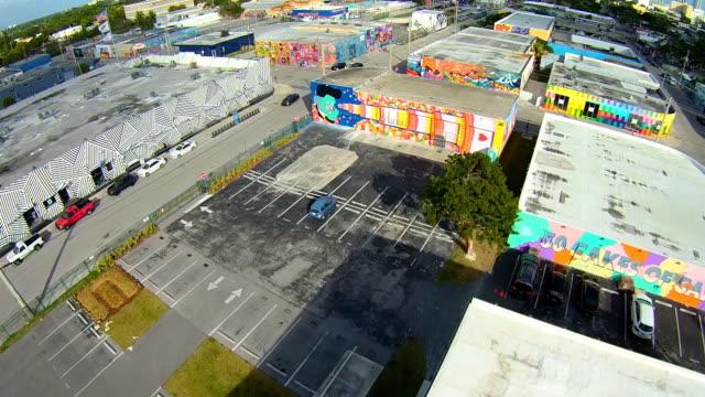 aerial flight wandering around wynwood art district, in miami florida. - miami stock videos & royalty-free footage