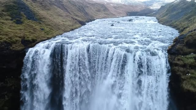 Aerial flight with drone over the famous Skogar waterfall , Iceland.