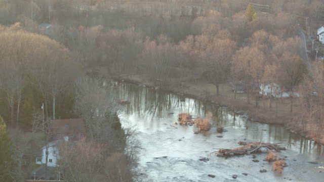 aerial floating above river bend on winter day in new york - river bend land feature stock videos & royalty-free footage