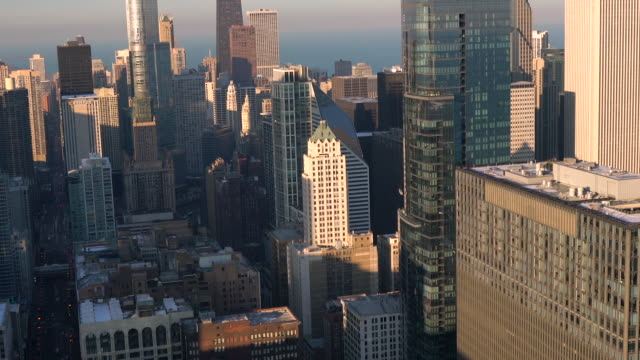 aerial floating around skyscrapers in downtown chicago on a sunny winter afternoon - one prudential plaza stock videos & royalty-free footage