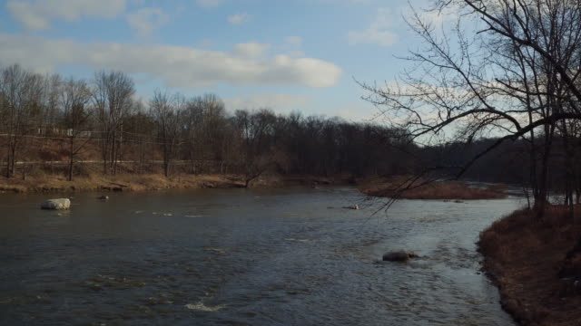 aerial floating over bend in a river on a winter day in new york state - new paltz stock videos and b-roll footage