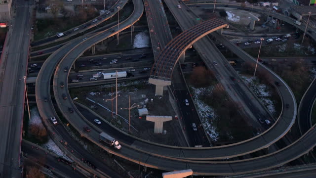 Aerial floating over major highway artery outside of Chicago on a winter afternoon