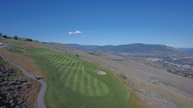 aerial fly by of golf course - golf shoe stock videos and b-roll footage