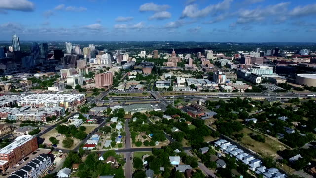 aerial fly over austin texas near interstate 35 - texas state capitol building stock videos & royalty-free footage