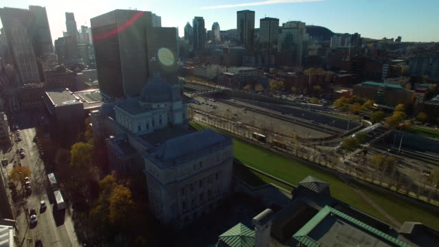 stockvideo's en b-roll-footage met aerial fly over of montreal city hall - town hall