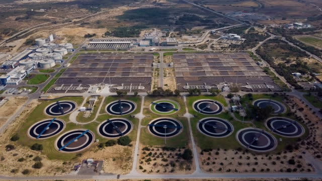 aerial fly over of sewage treatment plant /shafdan israel - sewage treatment plant stock videos & royalty-free footage