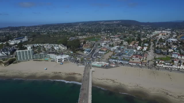 aerial flyby tilt down descend: santa cruz wharf & roundabout - santa cruz california stock videos and b-roll footage