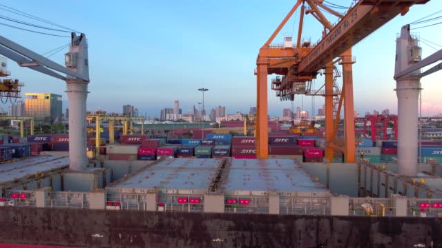 aerial: flying above a lot of cargo containers - docks stock videos & royalty-free footage