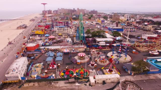 aerial flying across coney island, beach and atlantic ocean in brooklyn, new york city - coney island stock videos & royalty-free footage