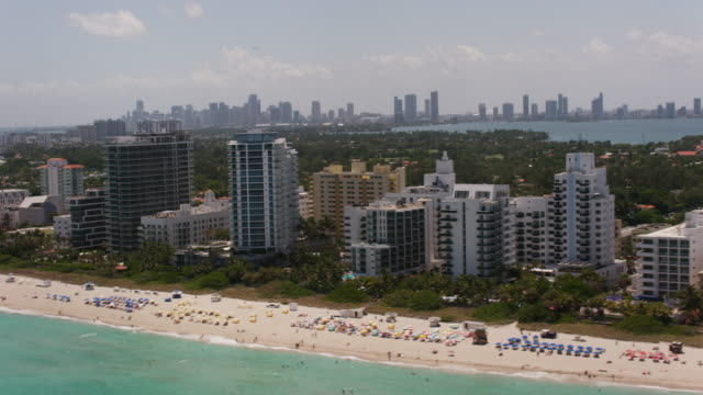 Aerial flying across South Beach, beautiful sunny day Miami FL