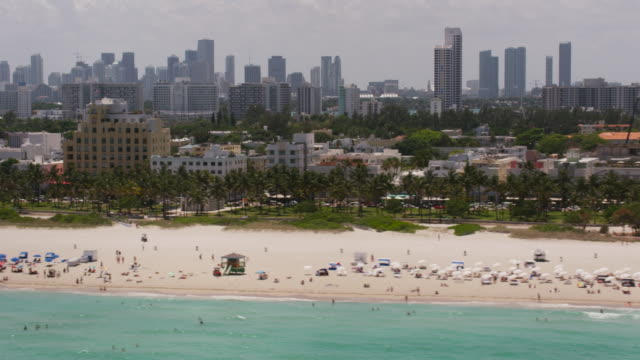 aerial flying across south beach, beautiful sunny day miami fl - miami video stock e b–roll