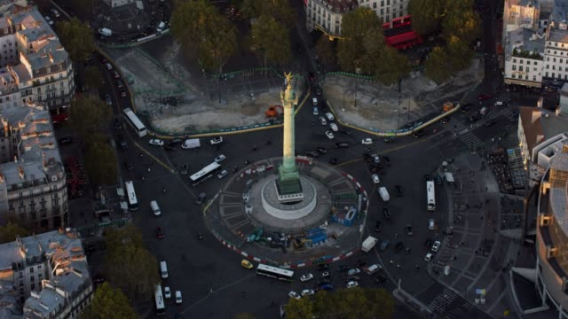 aerial flying around la bastille in paris france, sunset - バスティーユ点の映像素材/bロール